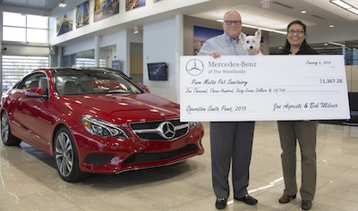 Mercedes benz of the woodlands gives a donation to pure for Mercedes benz of the woodlands