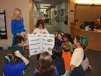 John Cooper third graders weigh in a hefty donation for Interfaith Food Pantry